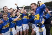 Tipperary players celebrate their promotion to division 2 of the National Football League